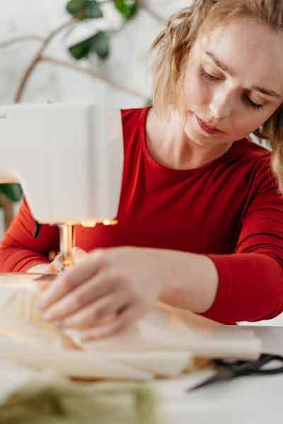 woman-inspecting-sewing-machine